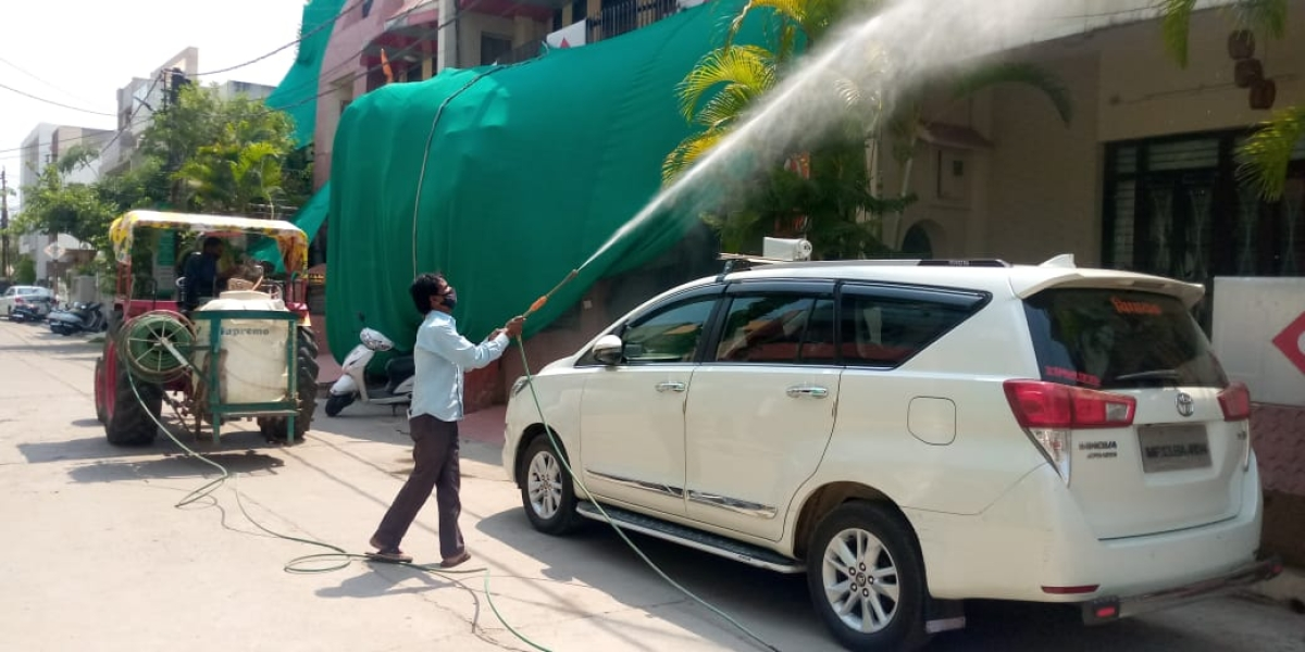 Ujjain Municipal Corporation employee sprays sanitisers in various localities of Ujjain on Thursday.