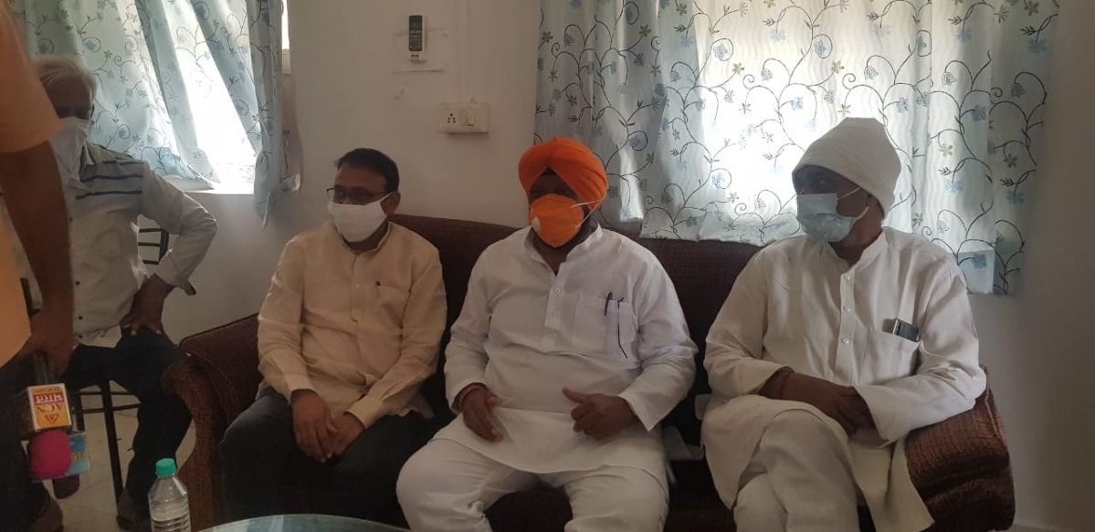 Minister Hardeep Singh Dang (centre) in Sanawad on Friday