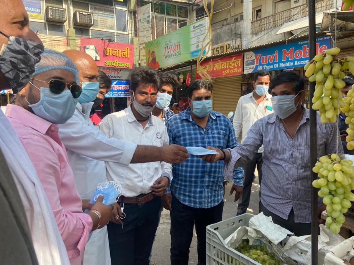 Mambers of National Student Union of India, distribute masks to mark 51st Foundation Day of the organisation, in Ujjain on Friday. They were led by MLA Mahesh Parmar, State NSUI vice-president Pritesh Sharma and district unit president Amber Mathur