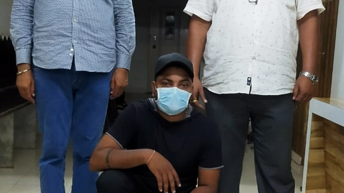 The accused lab technician in police custody