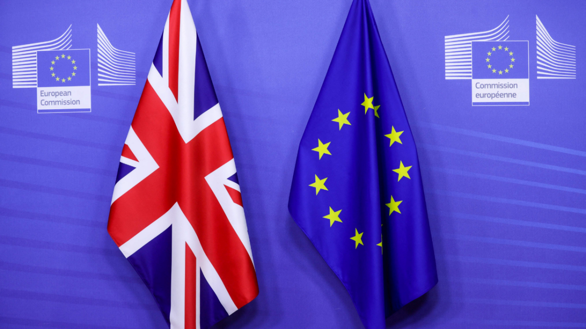 This file photograph taken on December 9, 2020, shows flags of the Union Jack and the EU ahead of the Britains Prime Ministers meeting on a post Brexit trade deal with the European Commission President, in Brussels.