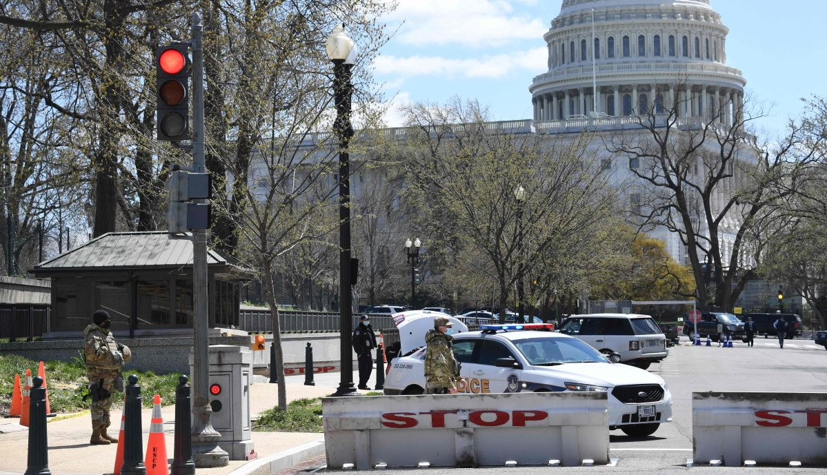US Capitol locked down after car rams barrier, injuring two cops; suspect shot