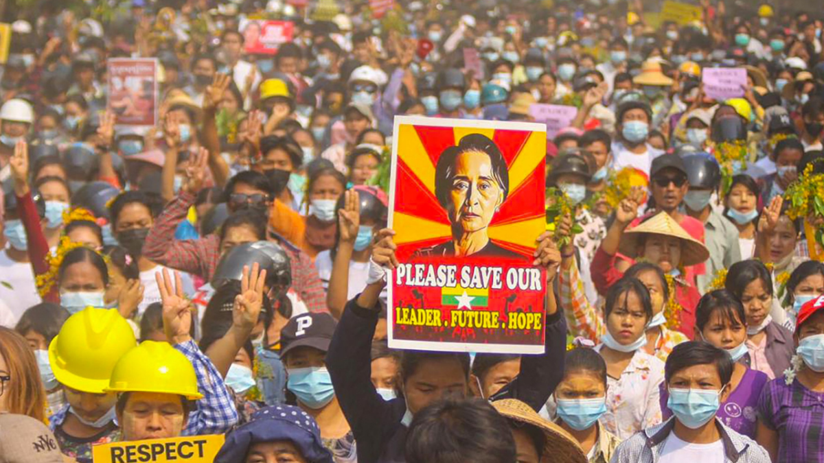 A protester holding up a poster featuring detained civilian leader Aung San Suu Kyi during a demonstration against the military coup in Monywa, Sagaing region./ File image