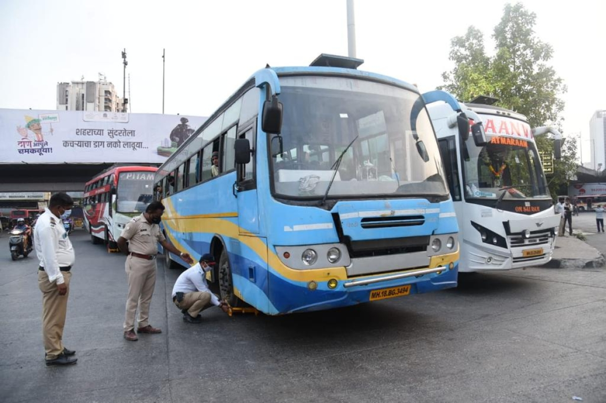 9 luxury buses crammed with migrants seized in Thane