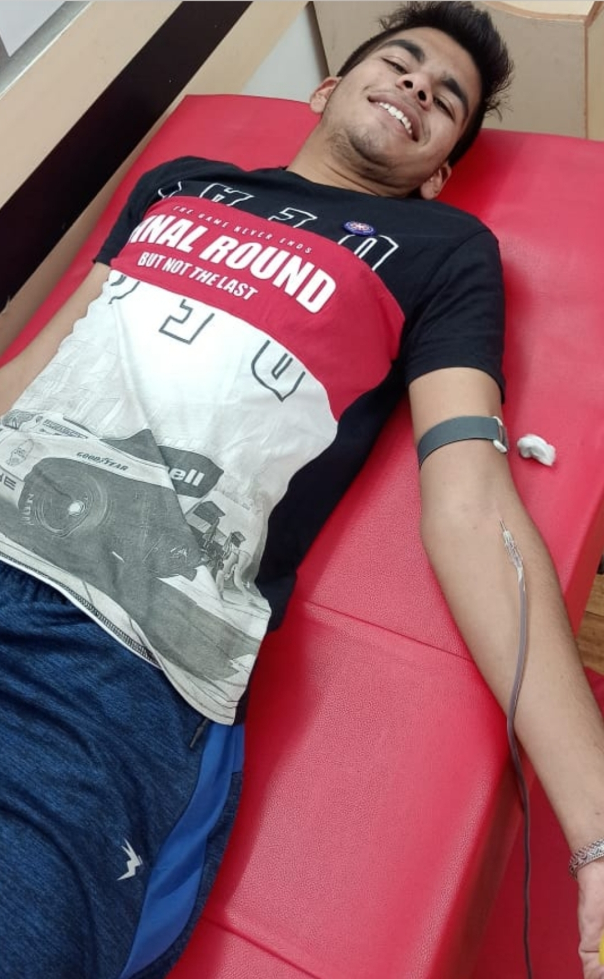 A boy student donates blood