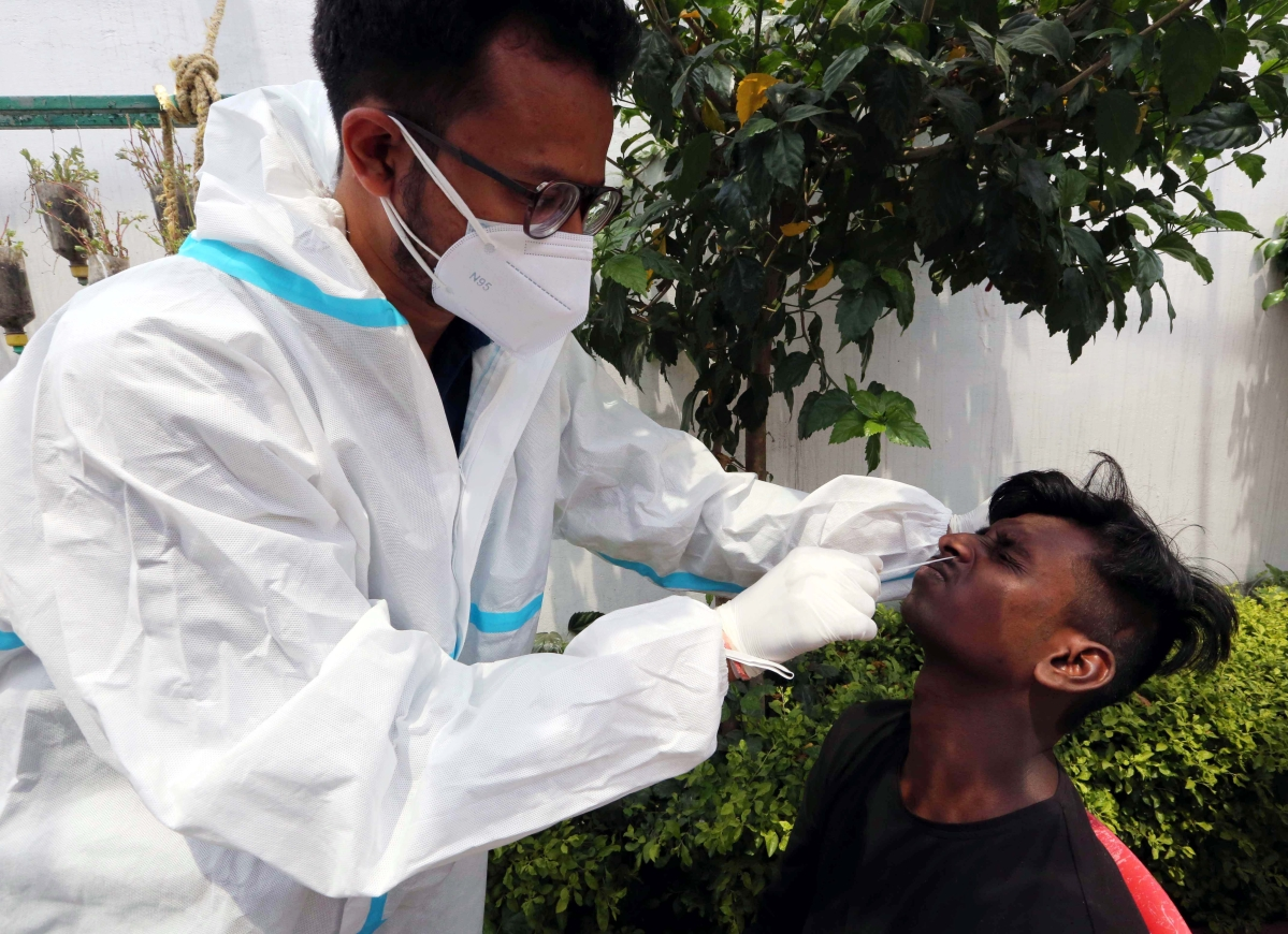 A health worker collects samples for Covid-19 testing amid surge in coronavirus cases in Bhopal on Friday.