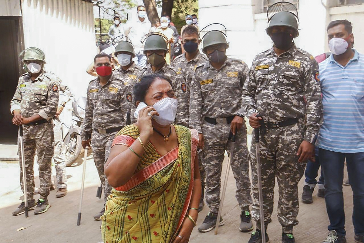 Nashik: A family member reacts after getting the news of medical oxygen gas leakage from a storage unit, which led to interruption in supply of oxygen to COVID-19 patients, in Nashik, Wednesday, April 21, 2021