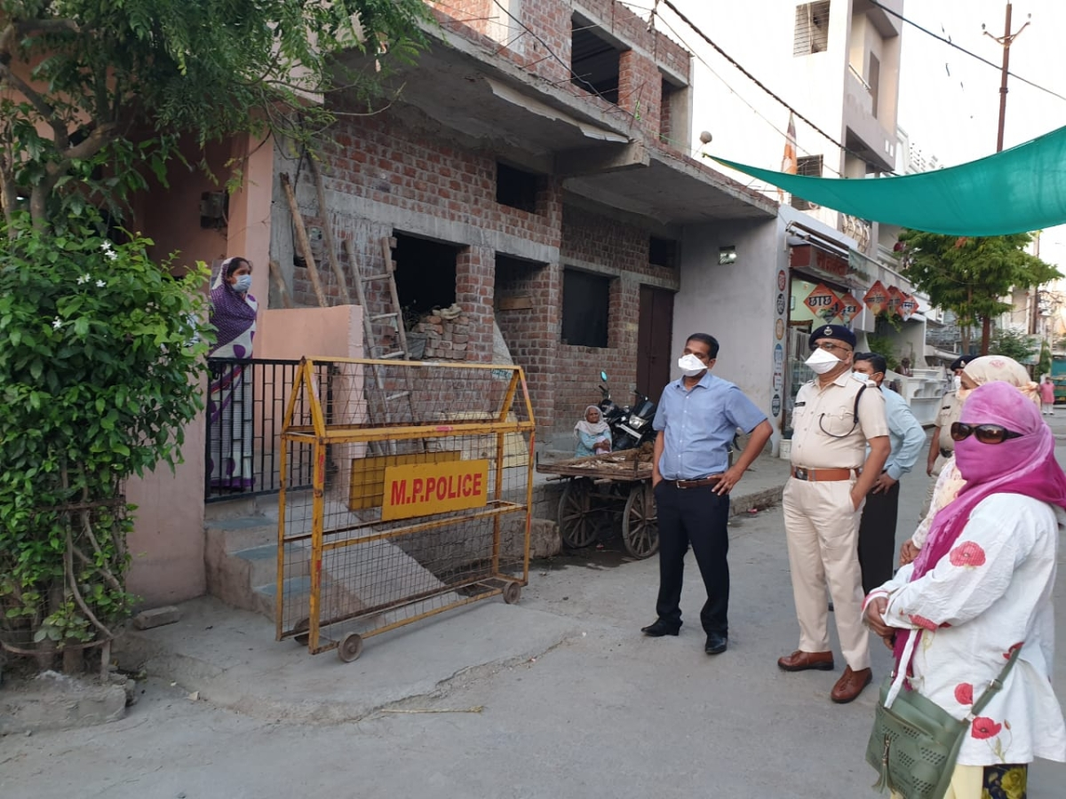 Keeping tabs: Collector Asheesh Singh, SP Satyendra Kumar Shukla among other officials inspected containment areas in Ujjain on Sunday evening