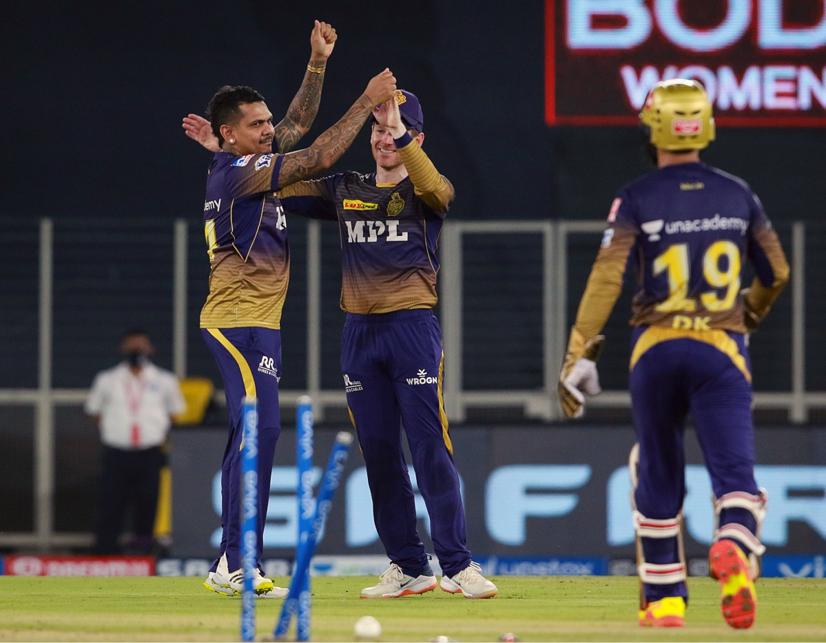Gujarat, Apr 26 (ANI): Sunil Narine of Kolkata Knight Riders takes a wicket of Moises Henriques of Punjab Kings during the match between the Punjab Kings and the Kolkata Knight Riders held at the Narendra Modi Stadium in Ahmedabad on Monday.