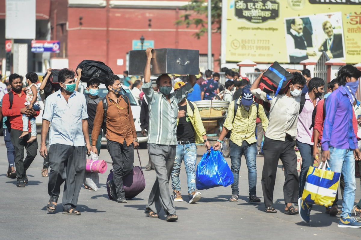 Lucknow: Passengers coming out from Charbagh railway station during weekend lockdown imposed in the wake of rising Covid-19 cases across the country, in Lucknow, Sunday, April 18, 2021.