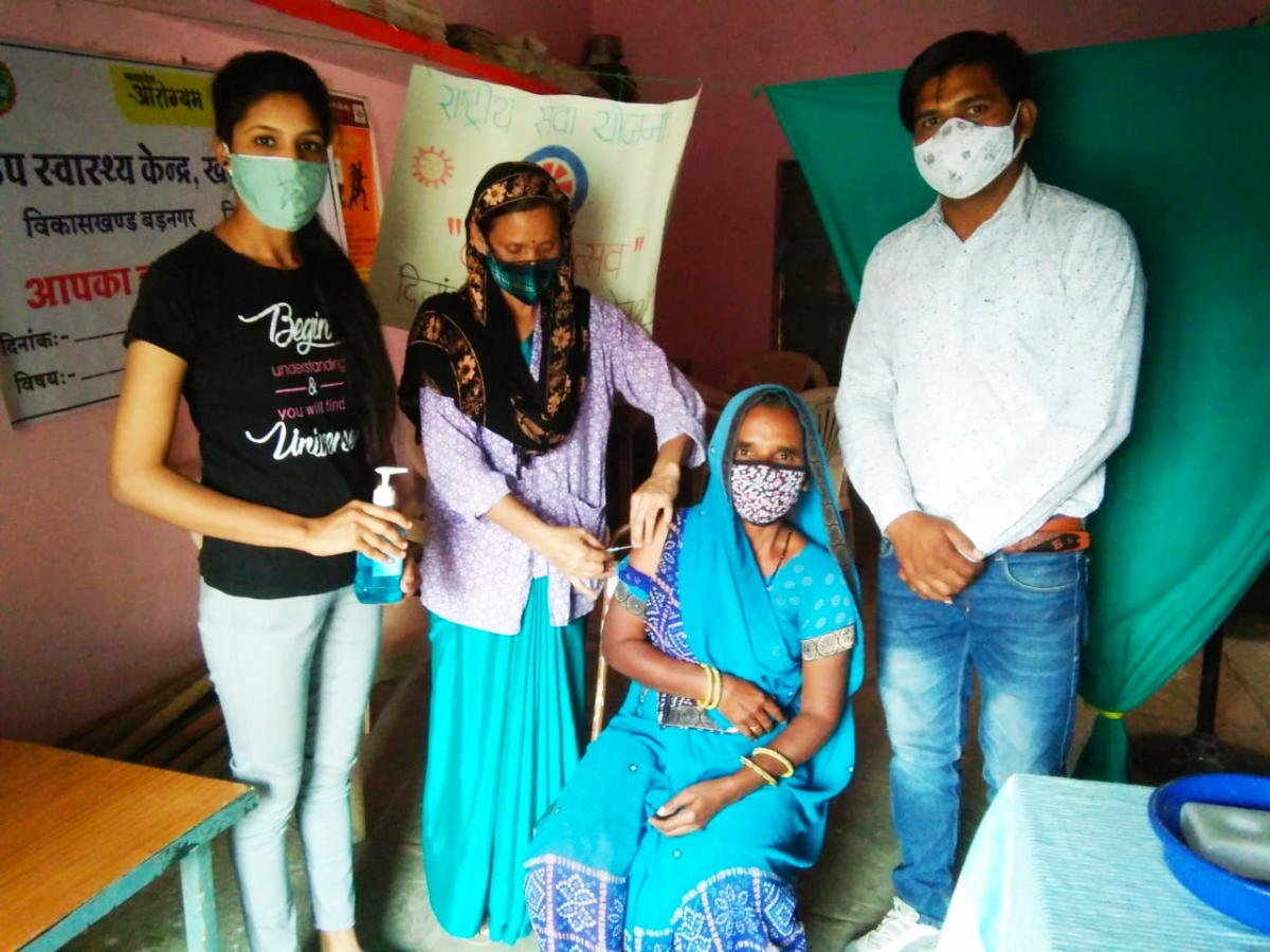 NSS volunteers of Bhartiya College present at the Corona Vaccination Centre along with villagers