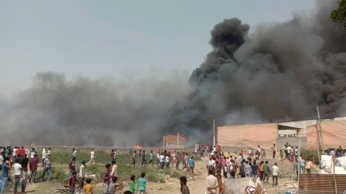 Noida: Smoke rises from a fire at a slum area in Bahlolpur village, in Noida district, Sunday, April 11, 2021.
