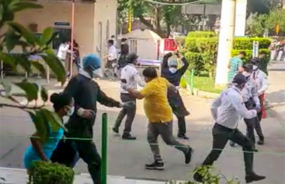 People clash after violence broke out between doctors, nurses and relatives of a COVID-19 patient who died after not finding a bed, at Apollo Hospital in New Delhi
