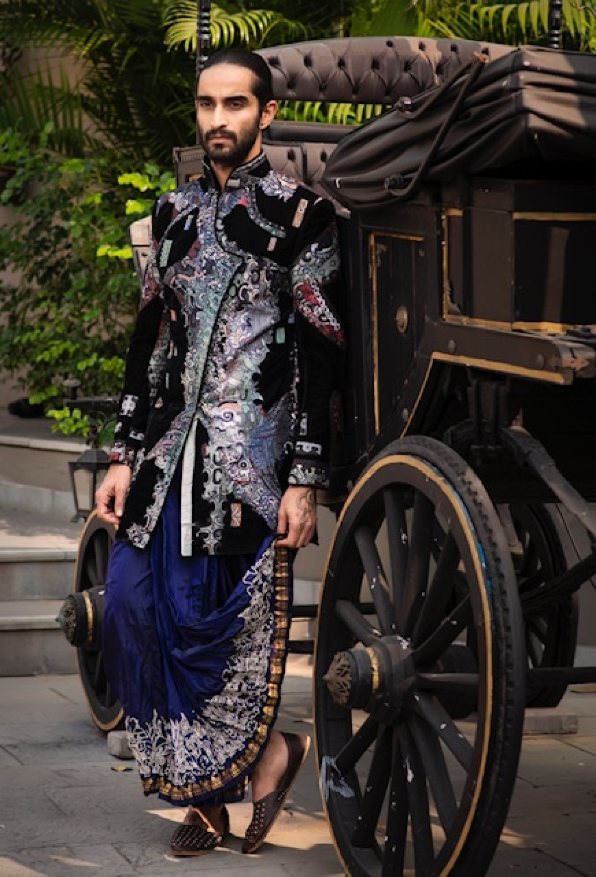 A classic indigo coloured dhoti paired with black jacket