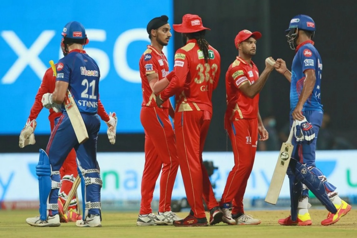 Marcus Stoinis of Delhi Capitals and Lalith Yadav of Delhi Capitals shake hands after win the match during match 11 of the Vivo Indian Premier League 2021 between the Delhi Capitals and the Punjab Kings held at the Wankhede Stadium Mumbai on the 18th April 2021.