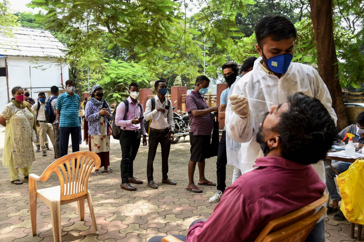 People queue up to give nasal swab sample to test for a Covid-19 coronavirus, in Mumbai on April 9, 2021.