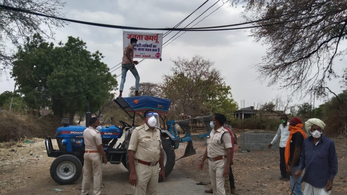 Rustic means! The measures to curb the spread of corona include the use of tractors, logs, thorny bushes and stones as barricades and banners to keep tabs on the movement of people to and from the villages in the Ujjain district
