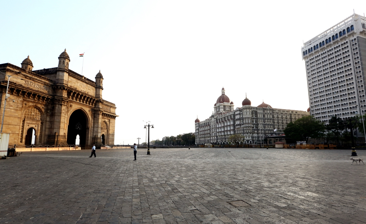 Maharashtra, Apr 12 (ANI): A deserted view of the road in front of the Gateway of India, Taj Mahal Palace, and The Oberai Hotel during a weekend lockdown, in Mumbai on Sunday.