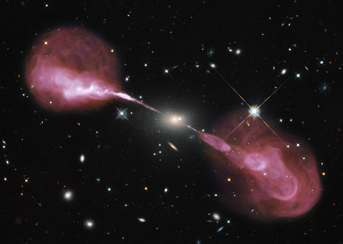 Spectacular jets are powered by the gravitational energy of a supermassive black hole in the core of the elliptical galaxy Hercules A. The jets shoot through space for millions of trillions of miles.