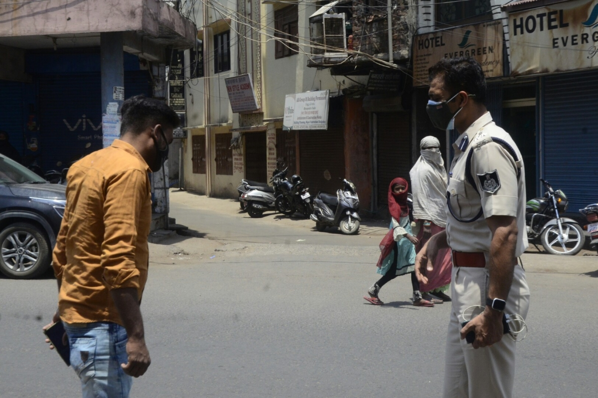 Only law-breakers and law-keepers on the roads under a blazing sun during the heat wave in Bhopal's Old City on Friday.