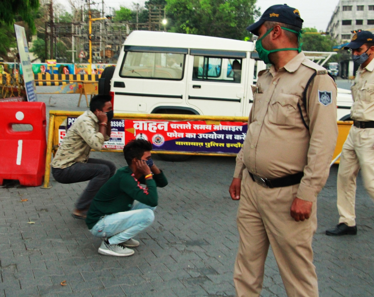 Making lockdown violators do sit-ups at Madhumilan Square