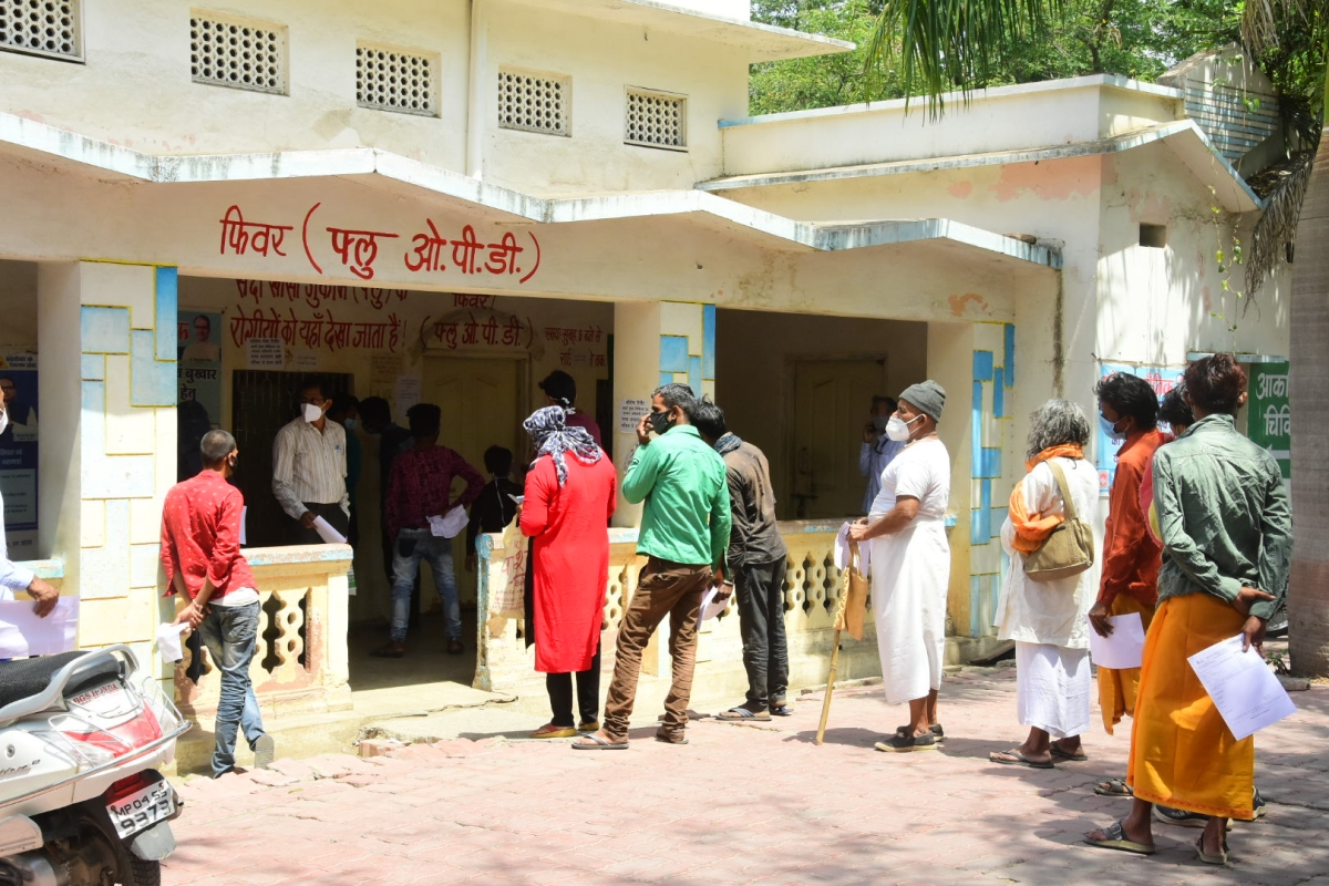 Patients make a beeline outside a fever clinic OPD in Ujjain on Friday