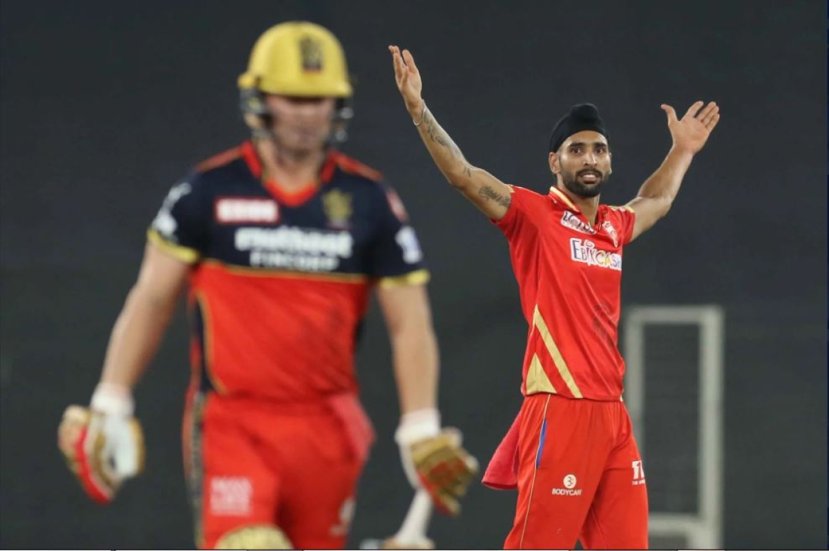 Harpreet Brar of Punjab Kings celebrates the wicket of AB de Villiers of Royal Challengers Bangalore during match 26 of the Vivo Indian Premier League 2021 between the Punjab Kings and the Royal Challengers Bangalore held at the Narendra Modi Stadium, Ahmedabad on the 30th April 2021.