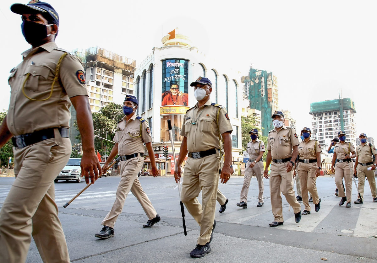 Mumbai: Police personnel conduct a flag march during COVID-induced lockdown in Mumbai, Wednesday, April 28, 2021.