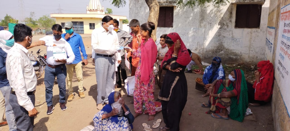 Atal Bihari Vajpayee Hindi University vice chancellor Prof Ramdev Bhardwaj distributed masks to people in Sukhisewania and Mughalia Kot villages on Monday
