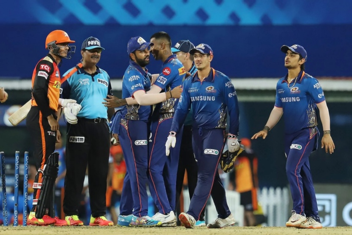 Mumbai Indians players greet each other after winning the match 9 of the Vivo Indian Premier League 2021 between the Mumbai Indians and the Sunrisers Hyderabad held at the M. A. Chidambaram Stadium, Chennai on the 17th April 2021.