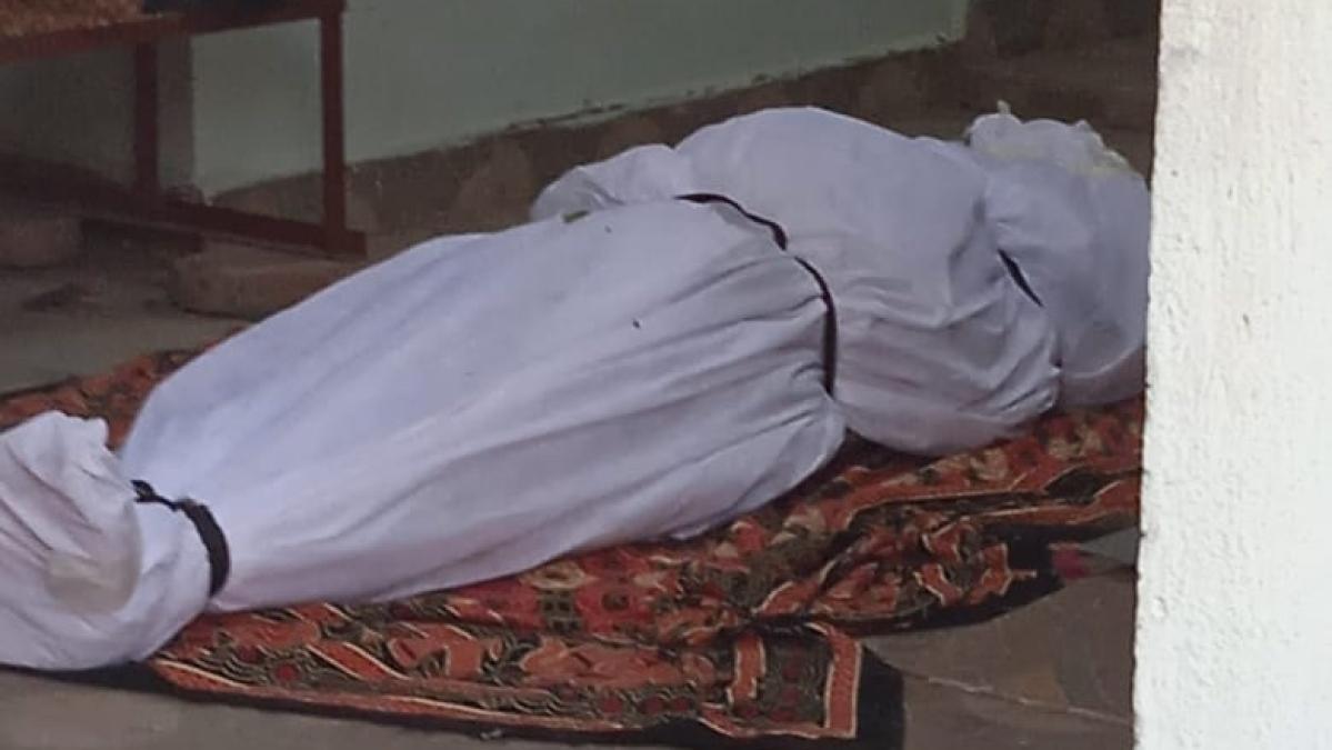 Body lying outside the house.