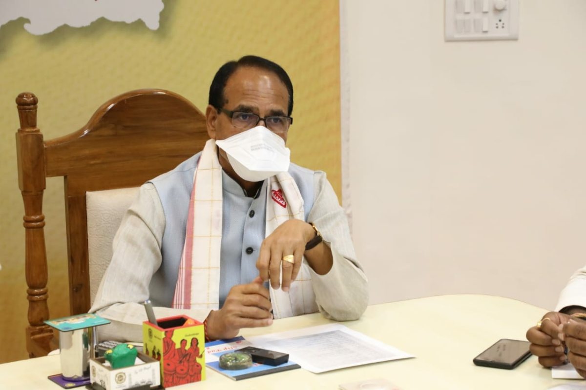Chief minister Shivraj Singh Chouhan presiding over meeting on corona control at his official residence in Bhopal on Monday