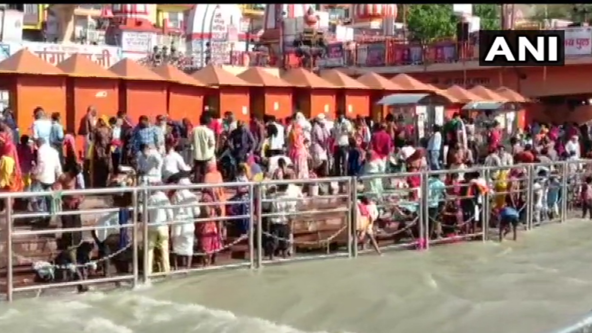 People take holy dip in river Ganga in Haridwar during the last 'shahi snan' of Kumbh Mela on 27 April, 2021.