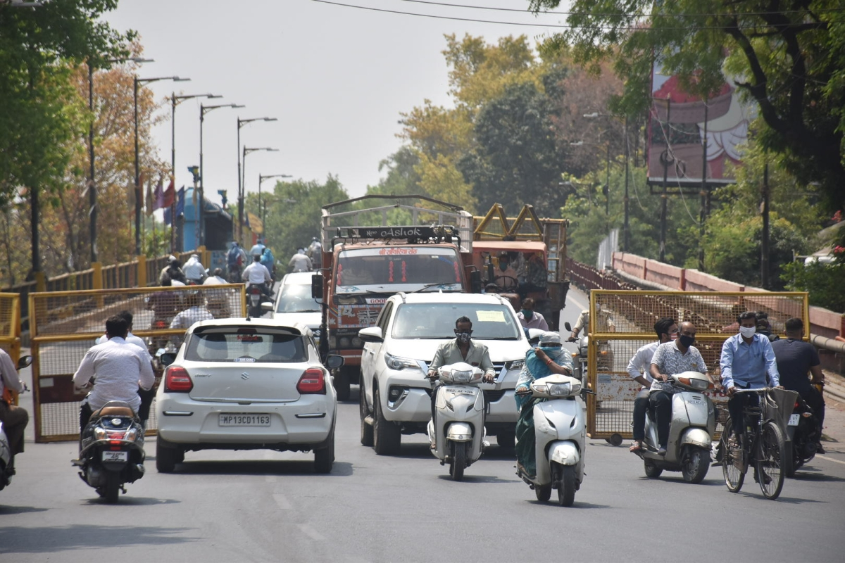 Despite imposition of Curfew the Janta continues to commute as usual on Freeganj Over-bridge among other main roads in Ujjain on Friday.
