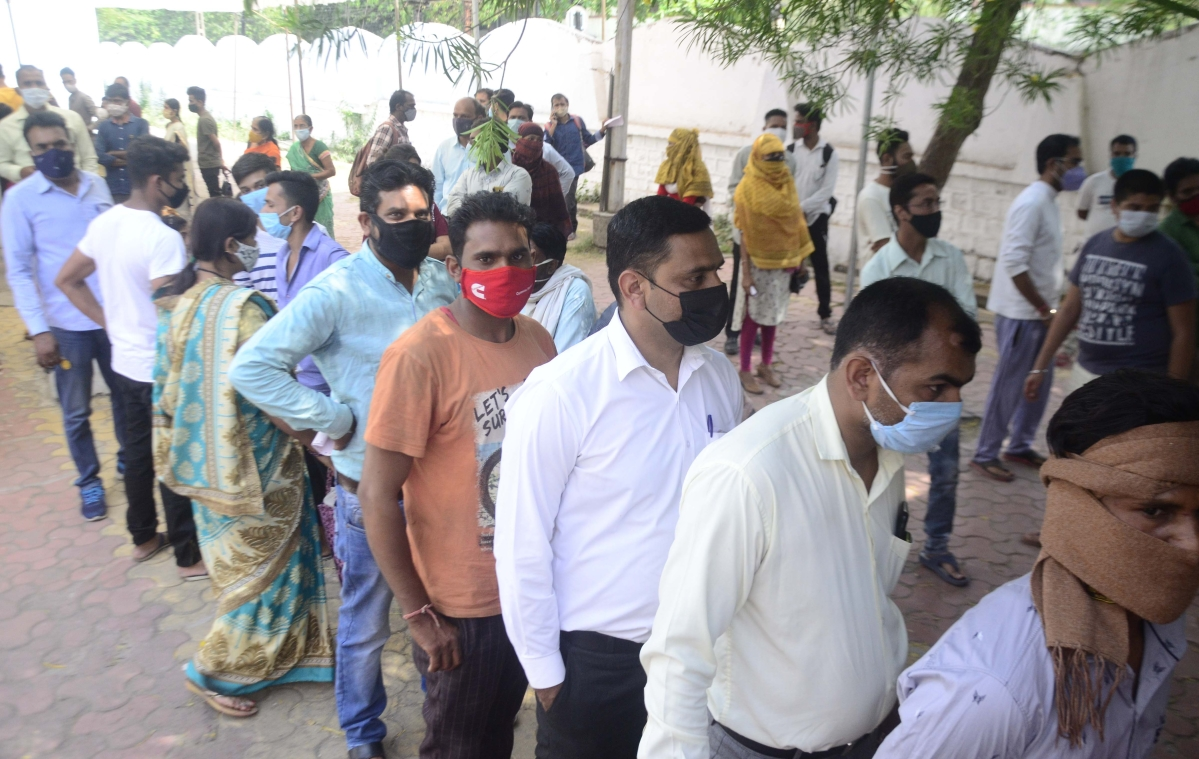 Long queue for corona testing at a fever clinic in the state capital, Bhopal.