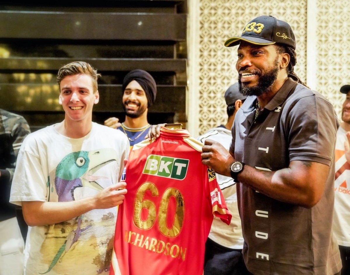Universe Boss Chris Gayle gives the Punjab Kings'Jersey to PBKS most expensive player Jhye Richardson