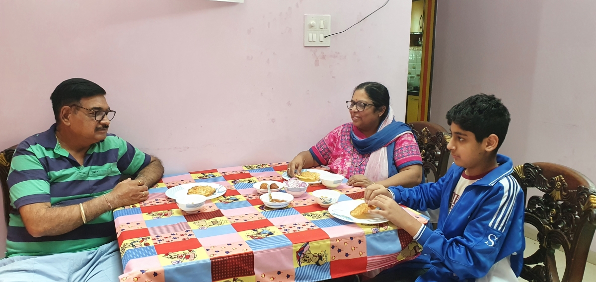 A Sindhi family enjoying Dal Pakwan at their house in Indore on Sunday
