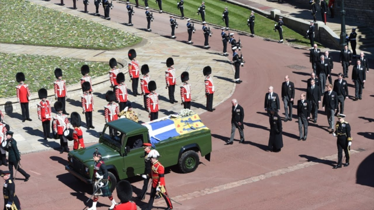 Members of the 1st Battalion Grenadier Guards place the coffin of Britain's Prince Philip onto a modified Jaguar Land Rover in the Quadrangle at Windsor Castle in Windsor, England