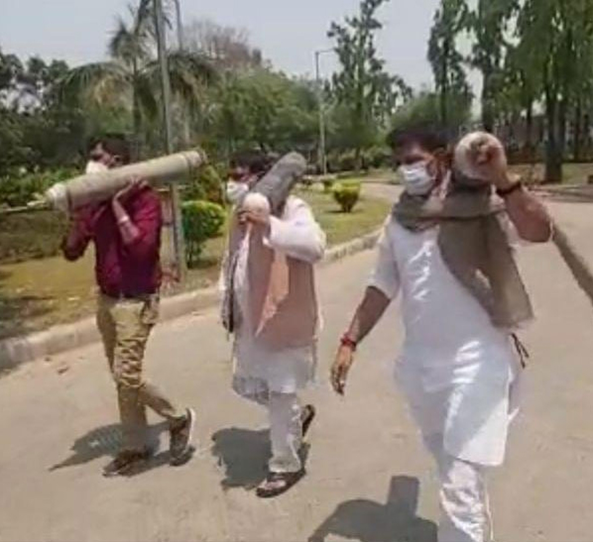 Cong MLAs carrying empty oxygen cylinders to protest venue.