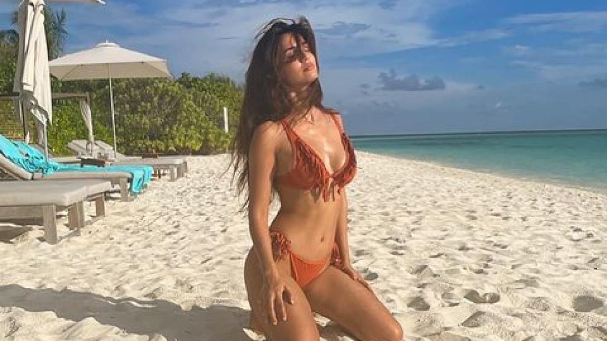 Sexy Disha Patani flaunts hourglass perfection in a bright orange fringed bikini