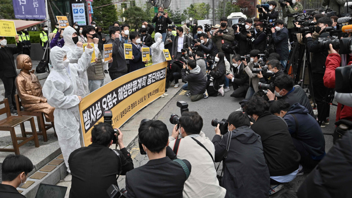 South Korean environmental activists stage a protest against Japan's decision on releasing Fukushima wastewater, near the Japanese embassy in Seoul on April 13, 2021