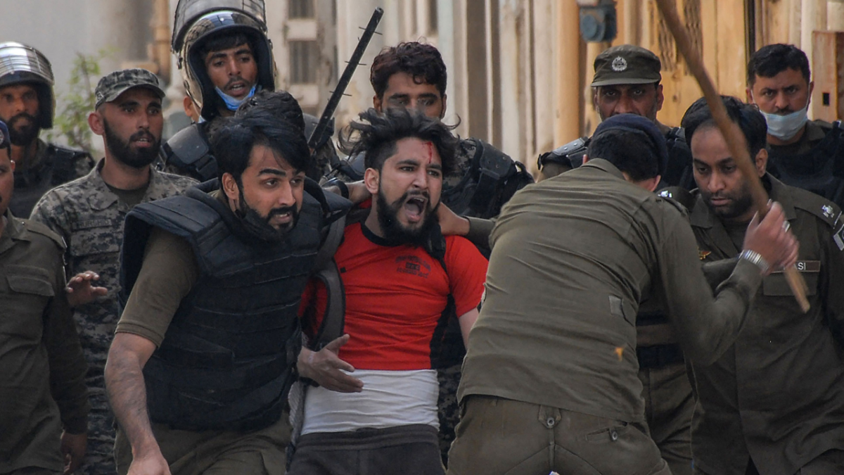 Policemen detain a supporter of Tehreek-e-Labbaik Pakistan (TLP) party during a protest against the arrest of their leader as he was demanding the expulsion of the French ambassador over depictions of Prophet Muhammad, in Rawalpindi on April 14, 2021.