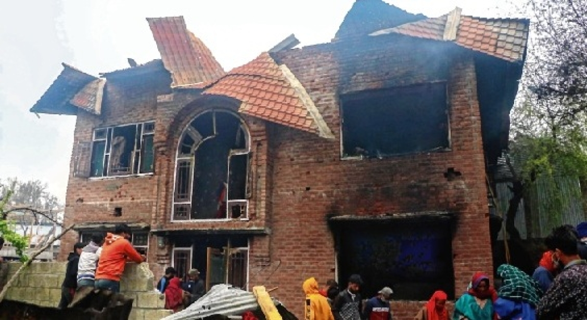 A damaged house near the encounter site in Anantnag on Sunday.