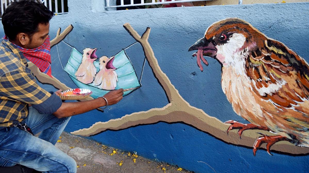 Maharashtra, April 04 (ANI): An artist makes a wall graffiti of a sparrow with an awareness message at Matunga, in Mumbai on Sunday.