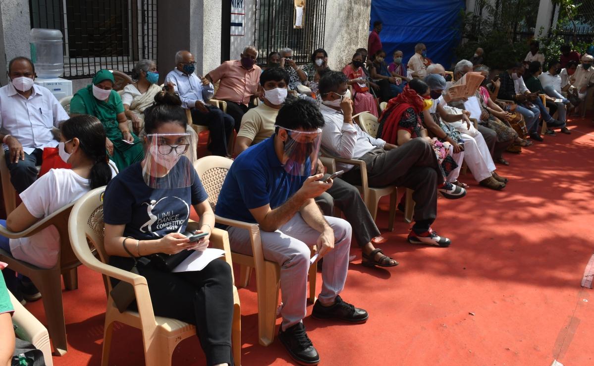 COVID-19 vaccine odyssey: Seniors, 45+ continue to wait in queue in Mumbai