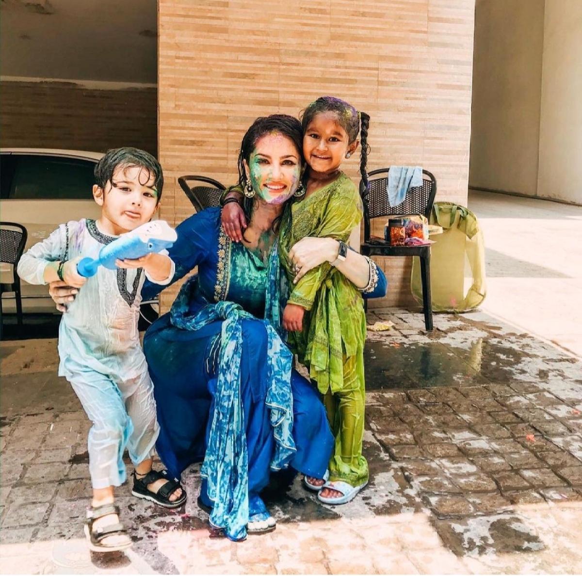 Sunny enjoying Holi with her kids