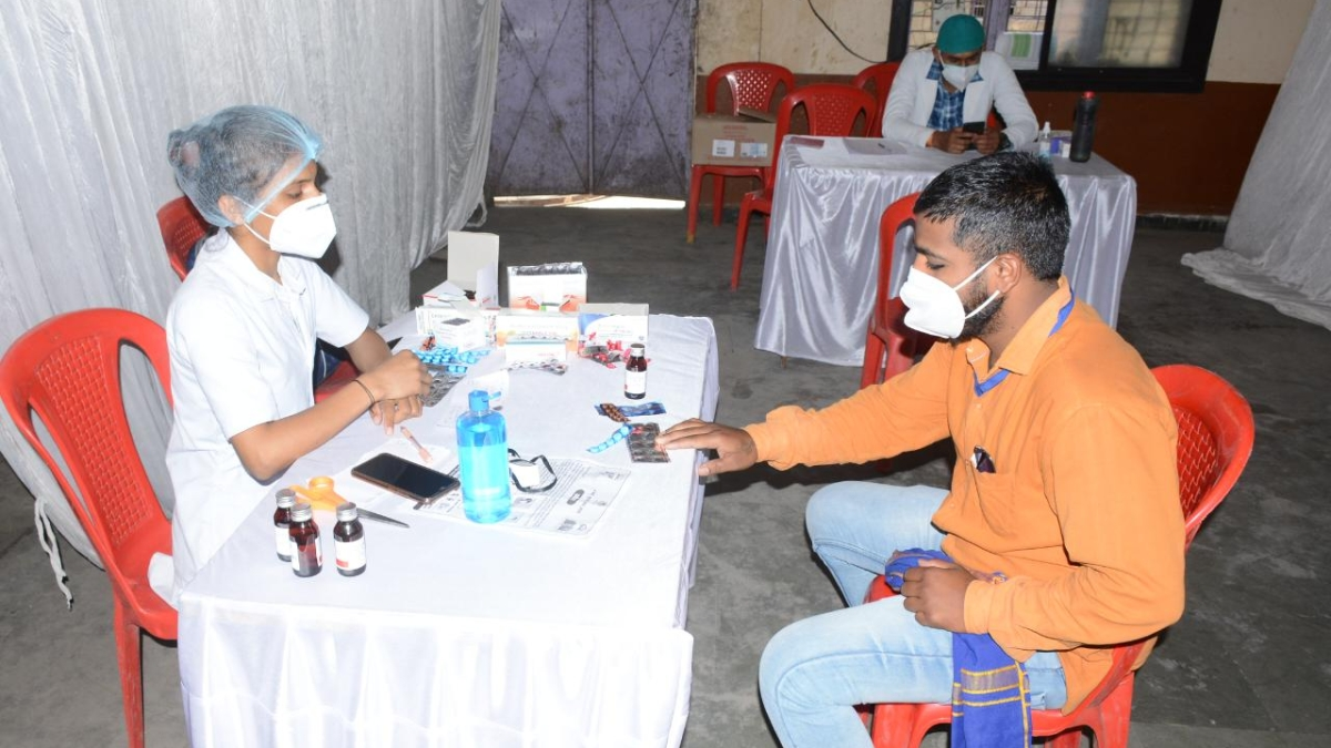 A medic examines a youth at a Covid-19 Assistance Centre set-up jointly by the Ujjain Municipal Corporation and local administration under 'Kill Corona-3 Campaign' in Ujjain on Saturday