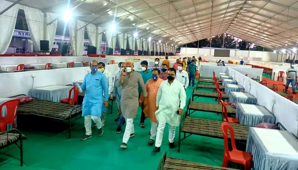 Minister surveys arrangements at an isolation coach at Bhopal railway station.