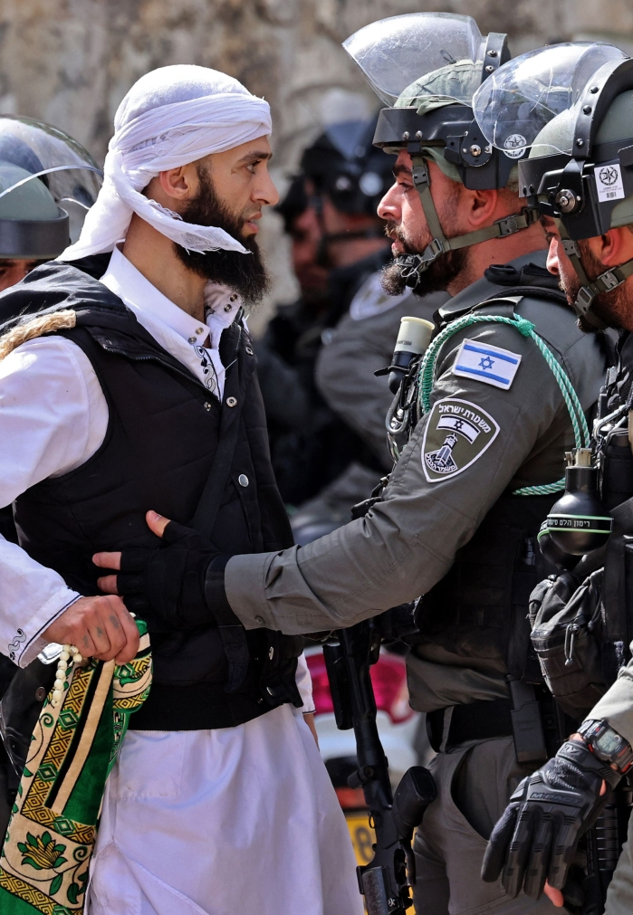 A Palestinian argues with Israeli security forces in Jerusalems Old City on May 10, 2021, ahead of a planned march to commemorate Israels takeover of Jerusalem in the 1967 Six-Day War.