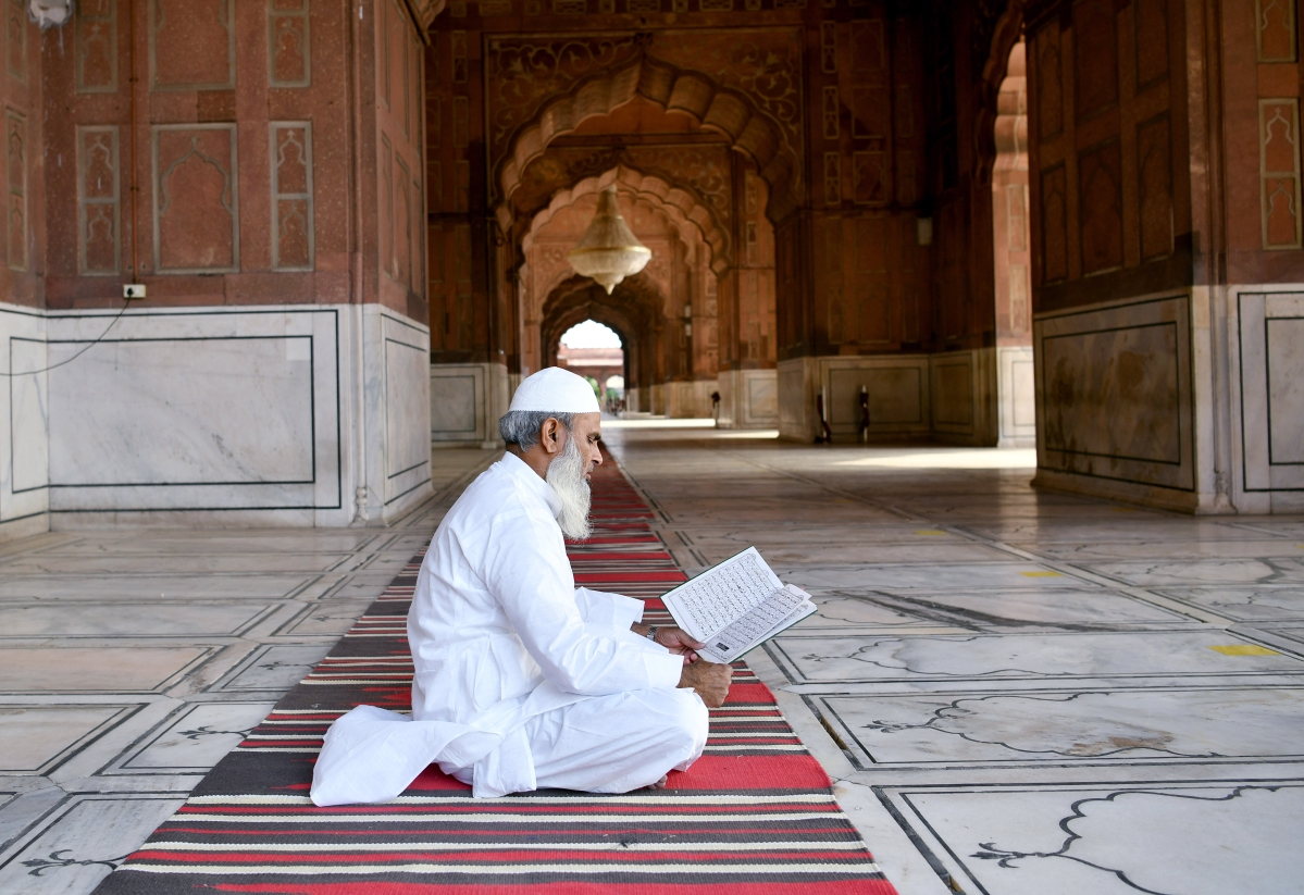 A Muslim devotee offer prayers outside the Jama Masjid mosque during Muslim?s Eid-al-Fitr festival marking the end of the holy fasting month of Ramadan amid the rise in COVID-19 cases, in New Delhi on Friday.